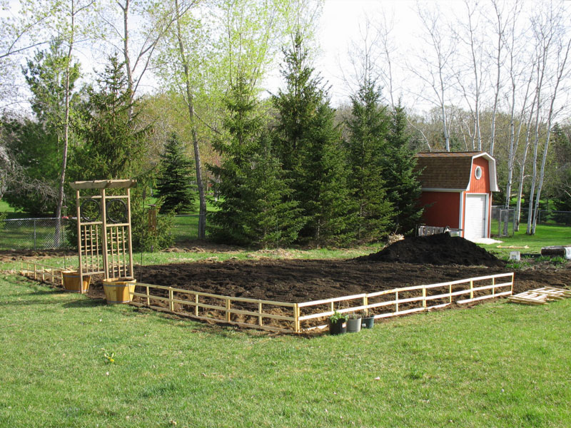 Garden tilled, arbor set up, fence started!