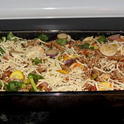 Pasta, Eggplant, Zucchini, Tomato Sauce topped with Daiya vegan cheese